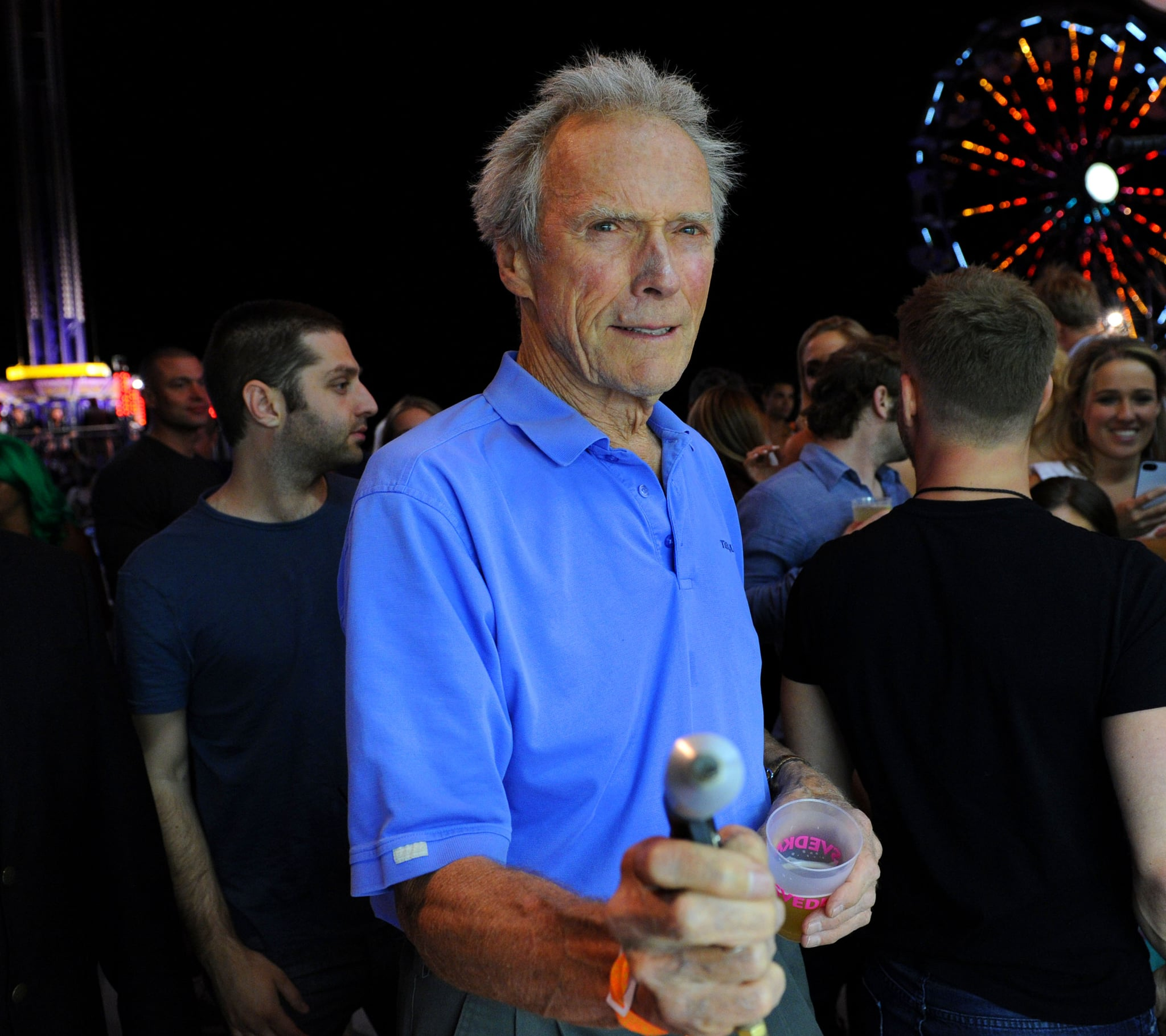 In 2013, Clint Eastwood played carnival games at Coachella's Neon Carnival. Photo courtesy of Seth Browarnik/WorldRedEye.com