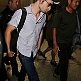 Robert Pattinson kept it casual for his travels.