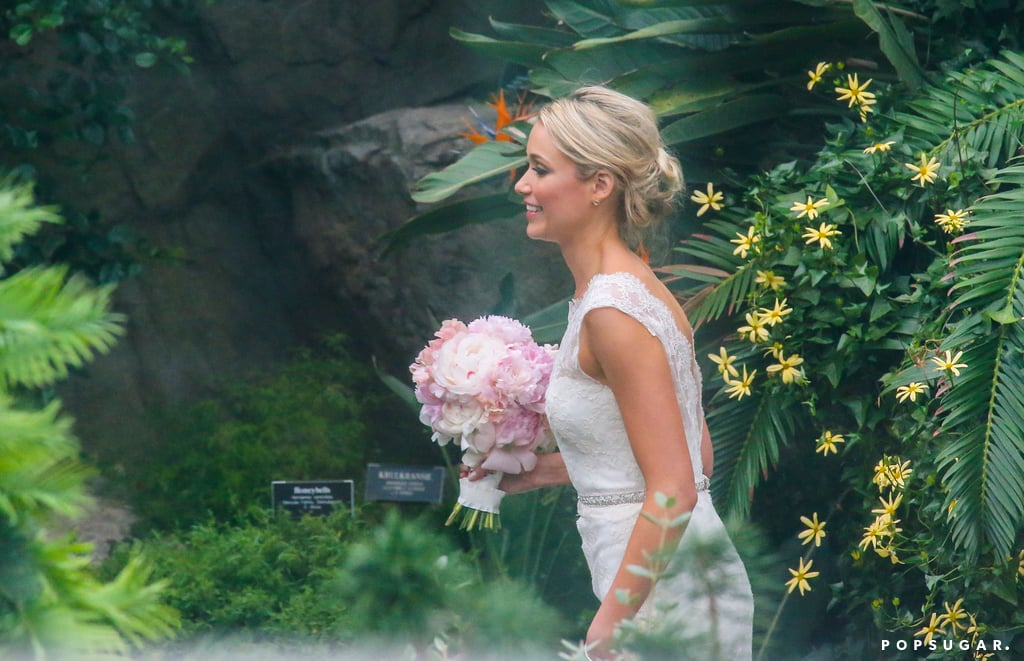 Katrina Bowden wore a white lace wedding dress.