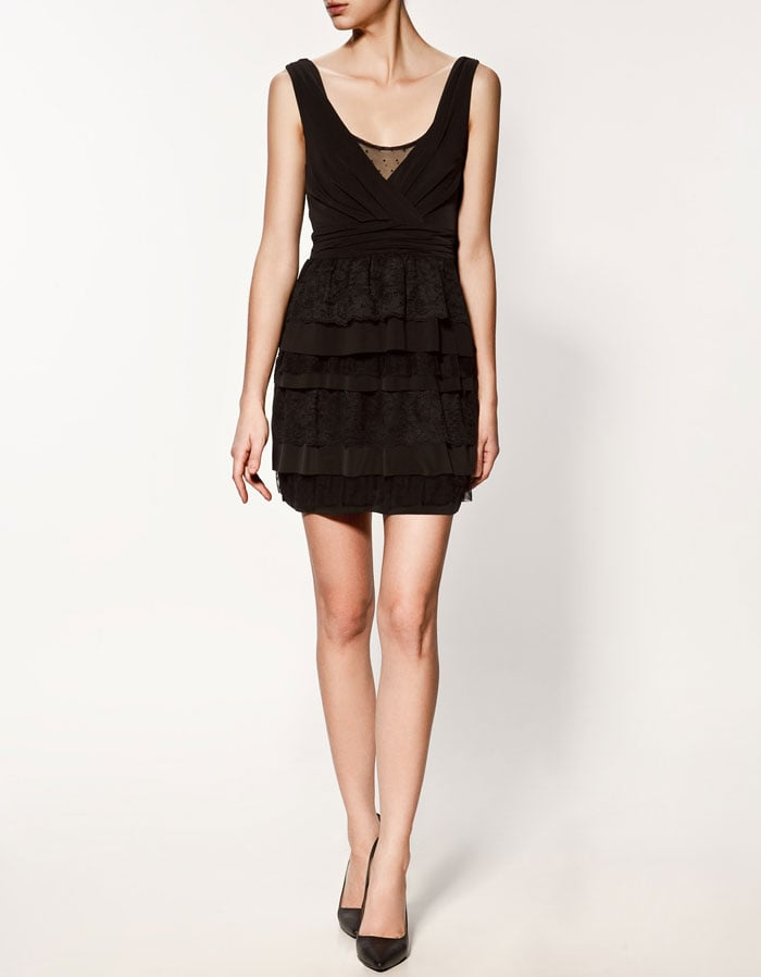 A classic fit gets amped up with sheer and lace detailing — this one will become a cocktail-dress staple.  Zara Dress With Frills ($80)
