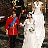 They sweetly held hands while making their way from the altar at their April 2011 wedding.