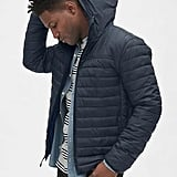 Whether he's always losing his hats or just prefers the added layer of warmth, this ColdControl Lightweight Hooded Puffer Jacket ($138) will keep him extra warm on cold days.