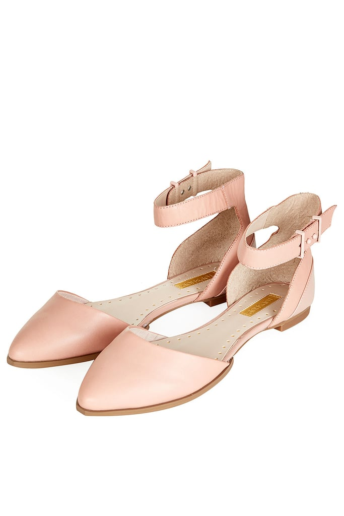 That leg-lengthening effect of nude shoes applies to flats, too. This Topshop Kouple 2 part buckle shoe ($69) would give your legs a lean line when added to a sweet miniskirt.