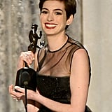 Anne Hathaway accepted her SAG Award on stage.
