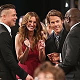 Brad Pitt cracked up with Julia Roberts, Danny Moder, and Steve McQueen at the Screen Actors Guild Awards.