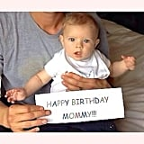 "Josh held his son, Axl, and a ""HAPPY BIRTHDAY MOMMY!!!"" sign for Fergie. Source: Instagram user joshduhamel"
