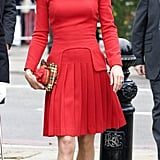 The duchess made her way to the event, dressed up in head-to-toe red, minus her signature nude LK Bennett pumps.