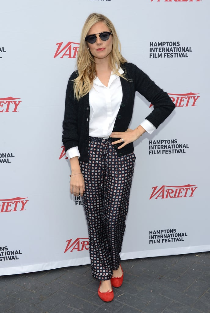 Sienna Miller sported sunglasses and a pair of red shoes to pose before the Variety Performers brunch at the Hamptons International Film Festival.