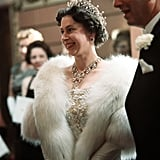 The bandeau necklace and Queen Mary's ruby earrings The distinctive V-shaped neck-piece was the then Princess Elizabeth's wedding present from her parents. The ruby earrings had been a birthday present from George V to his wife Mary, and were also passed down to Elizabeth.