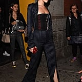 Bella Hadid Wearing a Corset Top and Striped Pantsuit