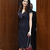 Amal chose an elegant navy sheath with a gathered center for a meeting at the UN in New York. The dress is one from the archives: John Galliano designed it for Christian Dior's label in the '90s.