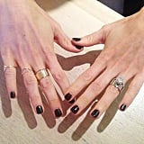 A friend of the POPSUGAR team took ring stacks to a whole new level with her stunning engagement ring — and black Shellac always works, no?