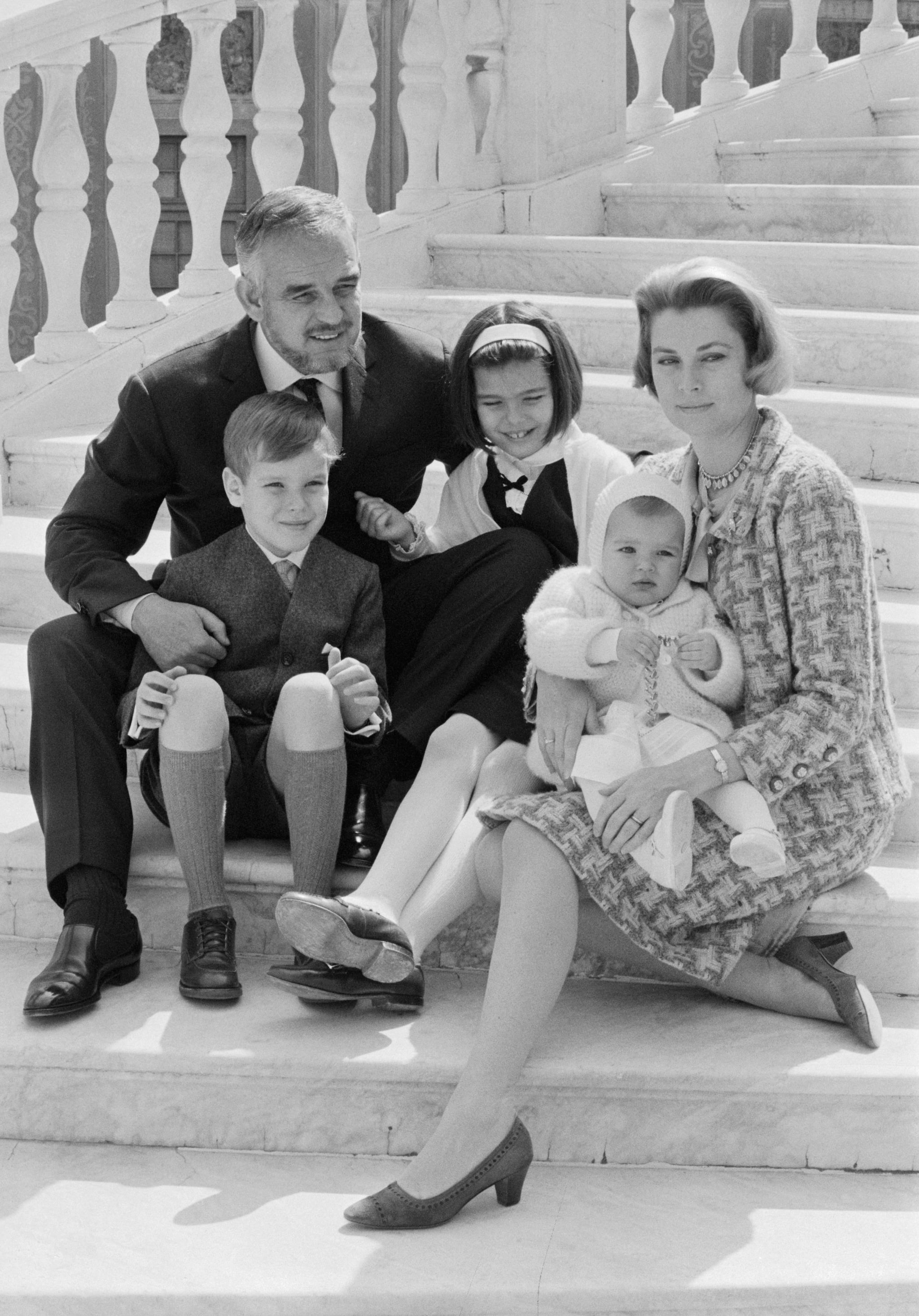 (Original Caption) Rainier and Grace Celebrate 10th Wedding Anniversary. Monte Carlo, Monaco: In connection with their tenth wedding anniversary celebration Prince Rainier and Princess of Monaco pose on the steps of the palace with their children: Princess Stephanie , 14 months; Princess Caroline, 9; and Prince Albert, 8. Asked to comment on 10 years of marriage, Princess Grace said:
