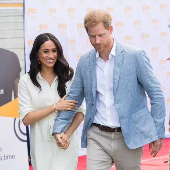 Meghan Markle Holds Hands With Price Harry in a White Dress