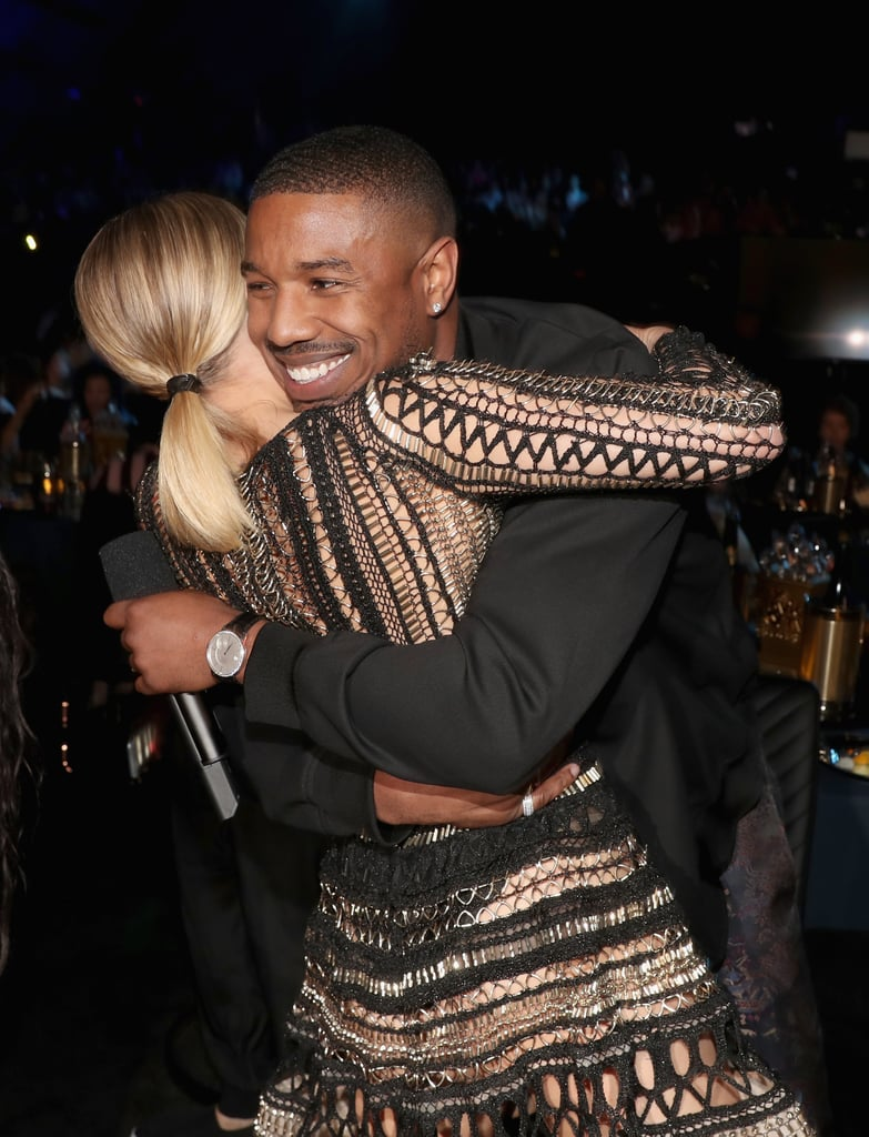 You know when you see that one person you worked with years ago out in public and can't believe how far they've come since? That appeared to be the moment when Kristen Bell spotted Michael B. Jordan at the MTV Movie & TV Awards in NYC on Saturday. At the show, which aired on Monday night, Michael and Kristen shared a sweet hug and posed for photos together in the audience, and the Black Panther star photobombed Kristen's snap with his Creed costar Tessa Thompson.       Related:                                                                                                           Here Are 20 Reasons Michael B. Jordan Should Be Your Man Crush Monday Every Day               The comfort between the two likely comes from the fact that they really have worked together before. Even though Kristen and Michael have never shared the screen, they cohosted the Academy of Motion Picture Arts and Sciences' Scientific and Technical Awards in January 2014 and presented on stage together at the Oscars weeks later. Kristen had recently gotten accolades for her voice-over role in Frozen, while Michael was fresh off his success from starring in Fruitvale Station. Since then, he's gained status as one of the stars of the highest-grossing superhero film of all time! See their cute MTV Movie & TV Awards reunion.