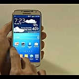 The Samsung Galaxy S4's display is five inches tall and boasts the world's first full HD super AMOLED 1920 x 1080 display. The phone, which runs on Android 4.2.2, has a new user interface that gets rid of the black bar at the top for a brighter, cleaner experience.
