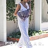 Jennifer Aniston in White Jumpsuit and Isabel Marant Slides