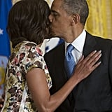 Michelle and Barack shared a kiss during a veterans event in April.
