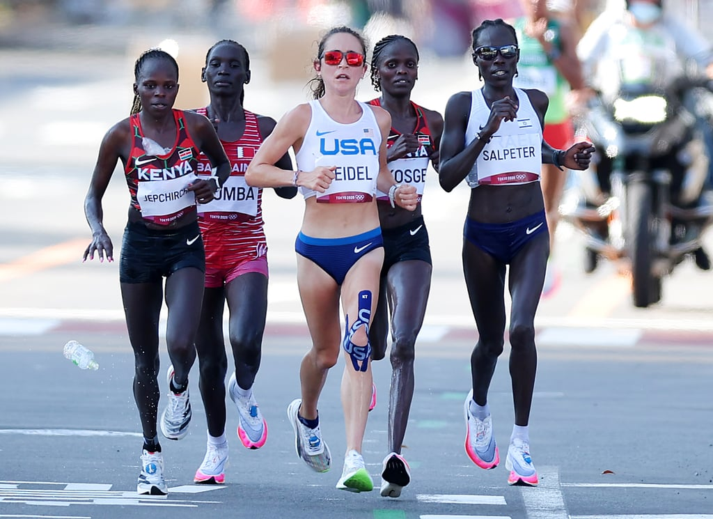 Molly Seidel just made her third career marathon count. The 27-year-old American shocked a stacked field by winning bronze at the 2021 Olympics, becoming the third American woman to medal in the Olympic marathon as she finished behind gold medalist Peres Jepchirchir and silver medalist Brigid Kosgei, both of Kenya. In extremely hot and humid conditions in Sapporo, Japan, the American team — Seidel, Aliphine Tuliamuk, and Sally Kipyego — wasn't expected to factor into the medal conversation. While Tuliamuk appeared to bow out out mid-race, Seidel and Kipyego quickly established themselves within the lead pack. Kipyego dropped up off and ultimately finished 17th, but Seidel maintained her controlled pace, often leading the thinning pack as the pace (and the heat) increased. Seidel eventually dropped off the Kenyans' pace but maintained a comfortable lead over fourth-place finisher Roza Dereje of Ethiopia. Seidel's time was 2:27:46, trailing half marathon world champion Jepchirchir with 2:27:20 and marathon world record holder Kosgei, who finished in 2:27:36.  For Seidel, it's a day to write her name in the history books. The Wisconsin native will now join two other legendary marathoners as the only American women to medal in the Olympic marathon: Joan Benoit Samuelson, who won gold in the inaugural women's race in 1984, and American record holder Deena Kastor, who took bronze in 2004. Ahead, see more photos of the medalists and the epic race.      Related:                                                                                                           Team USA's Tamyra Mensah-Stock Is the First Black Woman to Win Gold in Wrestling