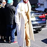 With a Light Jacket, Cream Turtleneck, Socks, and Loafers