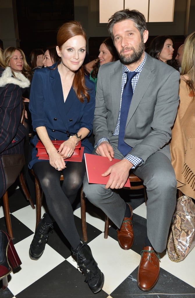 Julianne Moore chose a navy blue double-breasted coat dress, along with cool-girl booties and a red clutch, to take in the Tommy Hilfiger Fall '13 show.