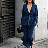 Opt For a Flared Pantsuit With Strappy Heels and a Clutch