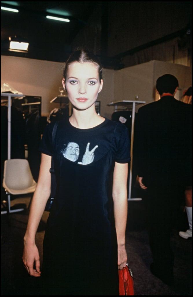 Backstage at Paris Fashion Week in 1994, wearing a statement tee.