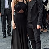 Angelina and Brad wowed the crowd at the World War Z premiere in their coordinating red carpet looks. Angelina's black Saint Laurent gown was in line with the actress's typically modest dresses, but fit her flawlessly, and revealed just a flash of skin with a sheer inset at the bodice.