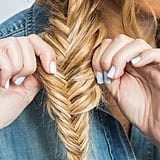 Muss up the fishtail braid, too, by pulling the edges apart slightly.