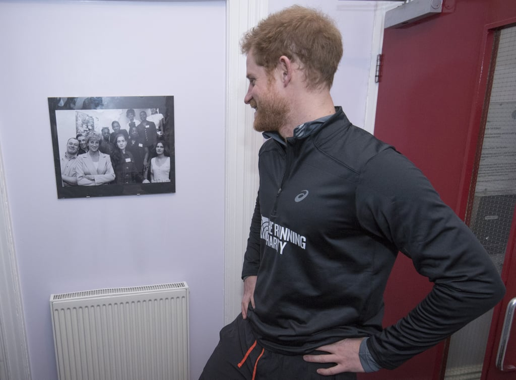 Harry admired a picture of his late mother during a visit to the Running Charity in January.