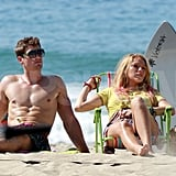Blake Lively with a shirtless costar shooting Savages.