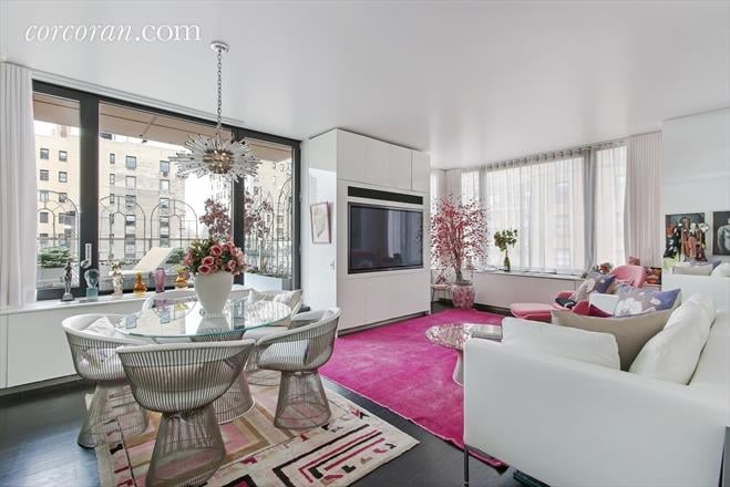 Fashion designer Betsey Johnson is known for her wild and playful designs on the runway, but at home it turns out she's a tad more tame. She recently listed her New York City condo for just under $1.8 million (about $55,000 less than what she paid for it back in 2008), and it's more understated than we were expecting. The 78-square-metre, one-bedroom space features white walls, curtains, and furniture against dark hardwood floors with pops of vibrant fuchsia accents. Funky midcentury modern furniture and a sputnik lighting pendant add the signature character Betsey is known for. Light streams in from the many windows and onto the 27-square-metre terrace. Betsey's condo is located in a swanky building in the Upper East Side neighbourhood. Two marble bathrooms and oodles of closet space – which a fashion designer, of course, needs – complete the stylish home. Take an up-close look in the pictures ahead.