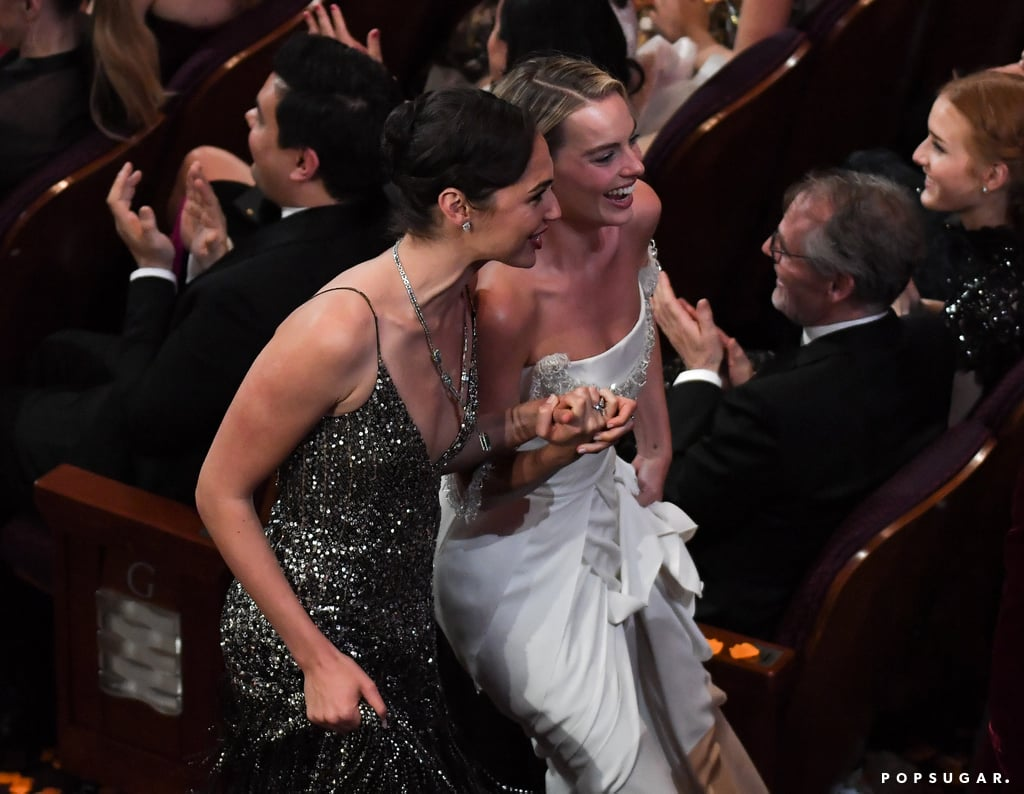 Gal Gadot and Margot Robbie held hands as they made their way through the aisle.