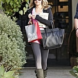 Ashley Tisdale brought Stephen King's 11/22/63 along for a shopping day in LA back in December 2011.