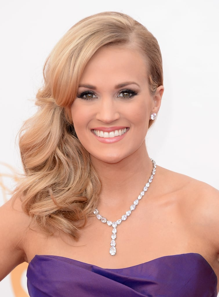 Carrie Underwood has a formula for red-carpet success, and for the Emmys she swept her curls over one shoulder.