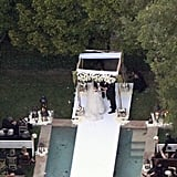 The bride walked down the aisle over a pool.