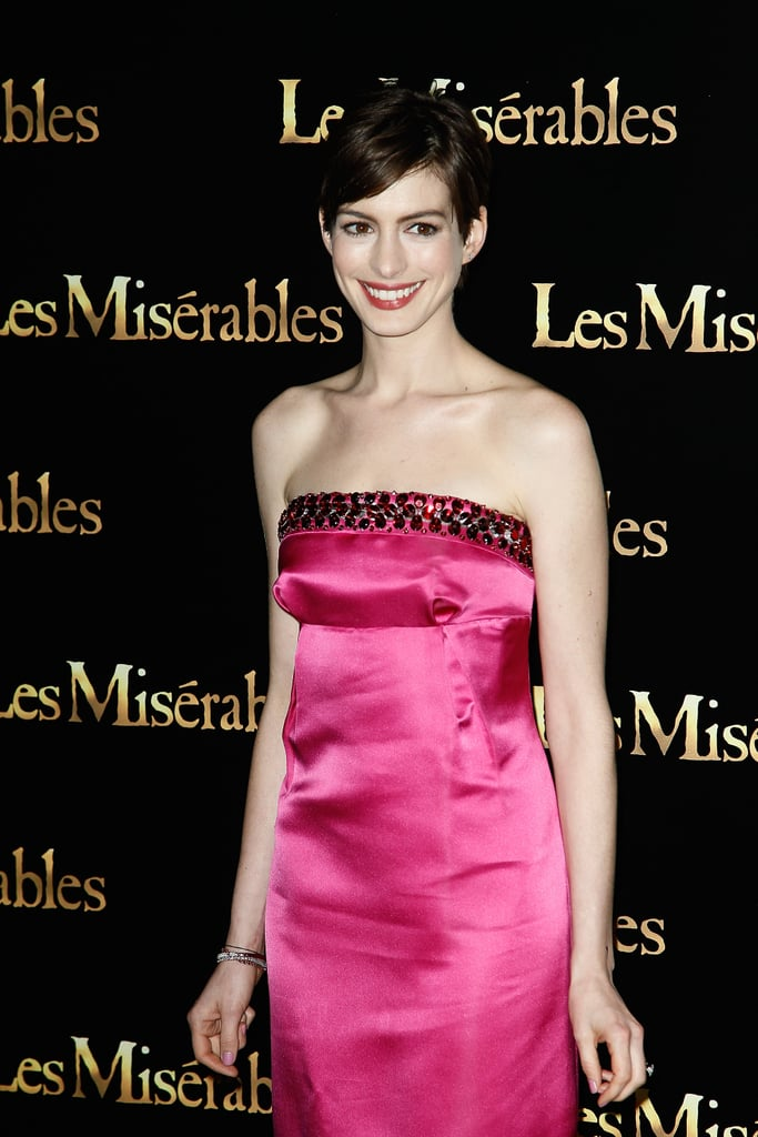 Anne Hathaway went strapless in Prada at the Paris premiere.