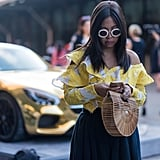 Pair two buzzy items like Self-Portrait's ruffled top and Cult Gaia's bag, and watch the compliments rolls in.
