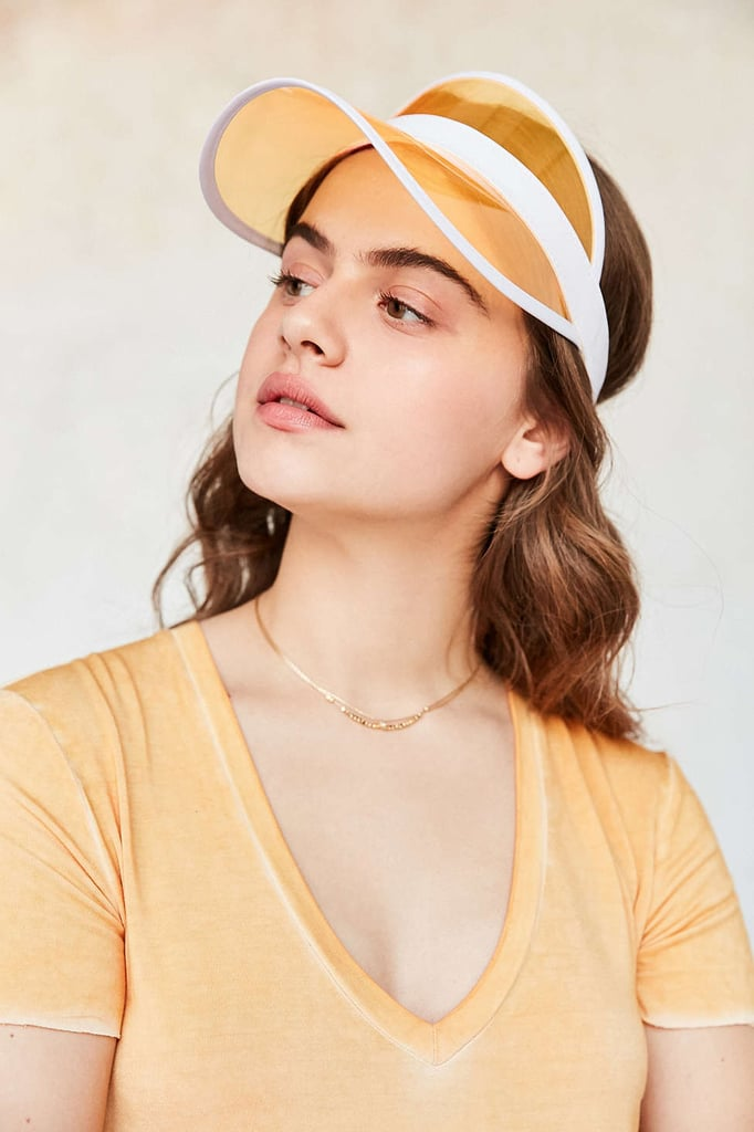 Urban Outfitters' Crystal Visor ($24) will protect the rays and lend you retro flair.