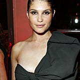Lancome celebrated with Lanvin designer Alber Elbaz during Haute Couture Fashion Week. Gemma Arterton joined the party wearing her hair slicked back to show off her metallic smoky eye makeup.