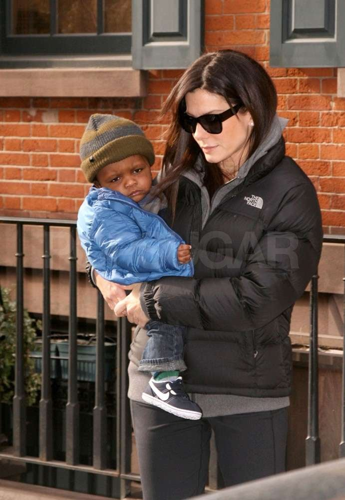 Sandra Bullock carried little Louis as they left their NYC apartment together this morning. The actress stepped out solo yesterday in workout gear, but brought her son along for today's outing. The pair have spent a great deal of the Winter in Manhattan, though Sandra took a quick trip West over the weekend to show off her blunt-banged style at the Golden Globes. Sandra laughed off rumors of a romance with Ryan Reynolds at the awards show, but her ex-husband, Jesse James, announced today that he plans to marry Kat Von D.