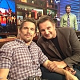 Odd couple Ethan Hawke and Liam Neeson got photo-bombed by the bartender on Watch What Happens: Live. Source: Andy Cohen on WhoSay