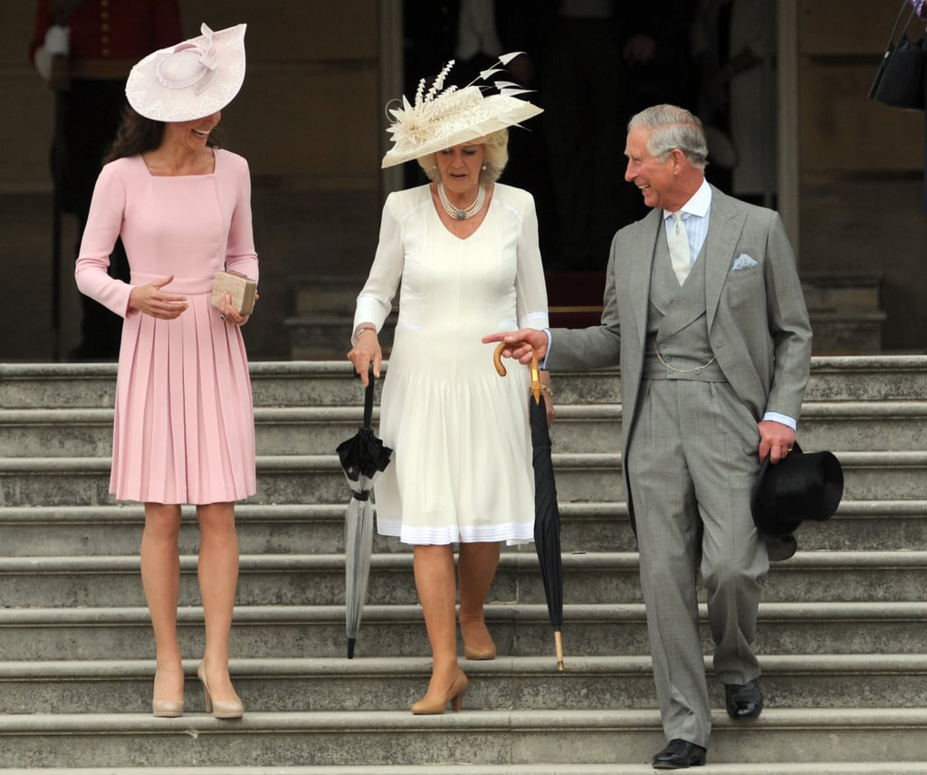 Kate Middleton, Camilla Parker Bowles, and Prince Charles walked down the stairs together at Buckingham Palace.
