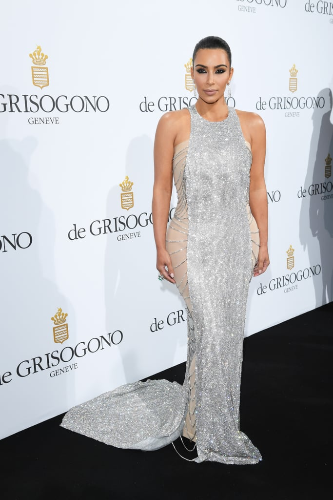 "Leave it to Kim Kardashian to shine bright like a diamond at the Cannes Film Festival. The reality TV star turned heads when she arrived at the De Grisogono party in a blindingly gorgeous two-tone crystal gown. At the event, Kim met up with mom Kris Jenner and pal Bella Hadid, who's clearly been enjoying her time in the South of France. Just before making her way overseas, the mother of three attended the Webby Awards in NYC, where she took home the Break the Internet Award and seized the opportunity to address those controversial nude snaps from earlier this year, announcing, ""Naked selfies until I die."" To see more of the festival, check out these cute celebrity candids."