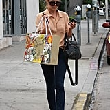 Lauren Conrad carried her Christian Louboutin shopping bag in one hand and her phone in the other.