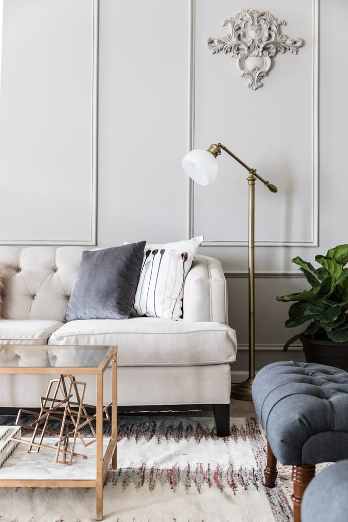 The room was already carpeted, but that didn't stop Monica from adding an amethyst area rug (from $81). An on-trend brass floor lamp and tufted seating, including a pair of dark grey linen lounge chairs ($253 each) make the room feel stylish and inviting.