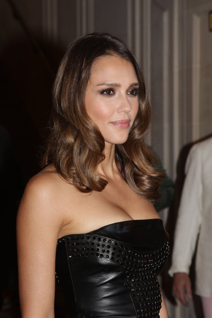 Jessica Alba wore her hair down at the Versace show for Paris Fashion Week.
