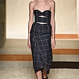 The look originally debuted on the runway with a cutout bustier and a pair of loafers.