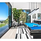 This room with a billiards table and a bar looks ideal for entertaining.