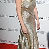 Kylie Minogue wore a shimmery gold Stella McCartney floor-length gown.